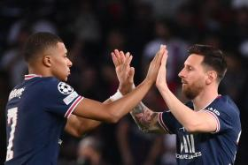 Kylian Mbappe (left) celebrates with PSG teammate Lionel Messi.