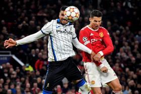 Cristiano Ronaldo scoring Manchester United's late winner with a header.