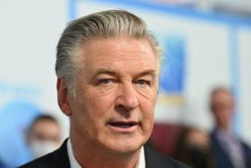 A woman has died after being shot during the filming of a movie starring Alec Baldwin, US law enforcement officers said October 21, 2021.