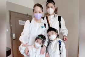Yvonne Lim and family in full PPE on flight back to Taipei