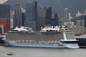 The Royal Caribbean cruise ship Spectrum of the Seas is seen docked at the Kai Tak Cruise Terminal in Hong Kong, China October 22, 2021.