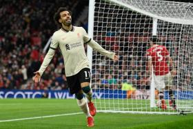 Mohamed Salah celebrates after completing his hat-trick and scoring Liverpool's fifth goal.