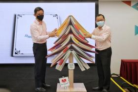 (From left) Education Minister Chan Chun Sing and FairPrice group chief executive Seah Kian Peng at the launch of the Share-A-Textbook scheme.