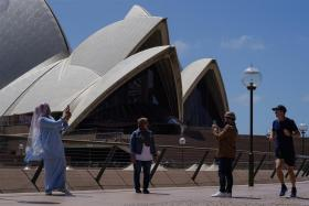 Visitors to the Sydney Opera House last week following months-long lockdown. Singapore residents looking to head to Australia for leisure will have to possibly wait until December for a two-way trip without quarantine.
