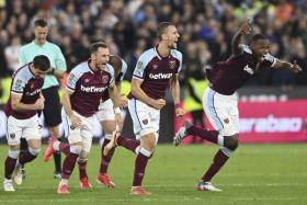 West Ham's players celebrate after winning the penalty shootout against Manchester City.