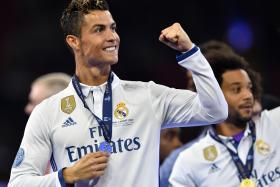 Real Madrid's Cristiano Ronaldo celebrates after winning the UEFA Champions League Final