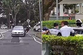 A video recording of the incident shows the driver and his passenger tussling with traffic police officers following a pursuit.