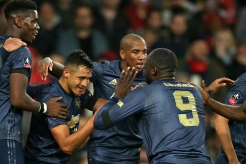 b639d6174f7aa Manchester United forward Alexis Sanchez (second from left) celebrates with  his teammates after scoring against his former club Arsenal.PHOTO  AFP