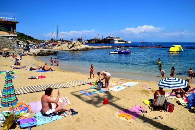 People having sex on crowded beach