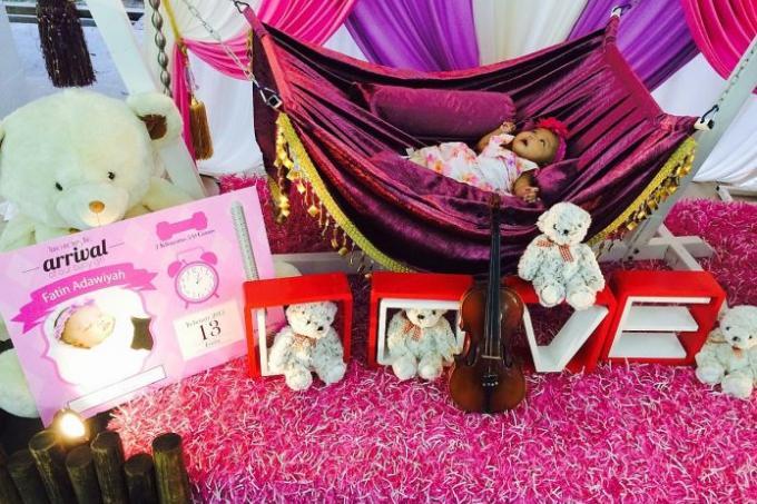 Parents splurge on newborn celebrations latest singapore for Baby cradle function decoration