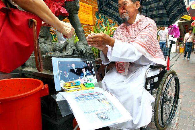 Parrot Man Now Selling Tissue Paper Outside Temple