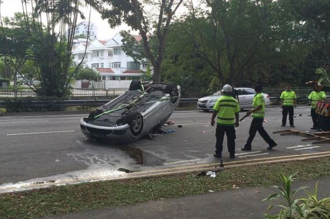 Driver S After Car Overturns On Bukit Timah Road