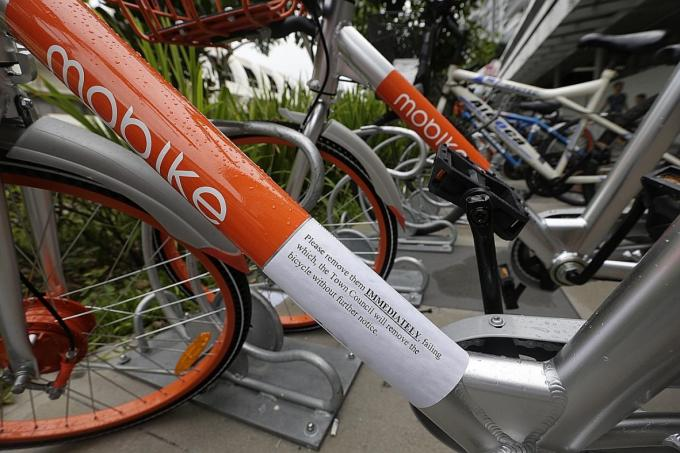 Town council: Parking racks not for use by rental bikes ...