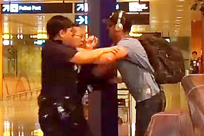 australian who tussled with policemen at changi airport to